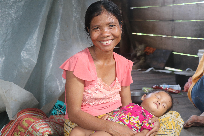 Bora putting her fifth kid to sleep at her stilt-wooden hut in Kantuot Village, Choam Ksan district, Preah Vihear province