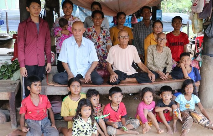 Population Census reaches remote parts of rural Cambodia, here three-generation family captured.